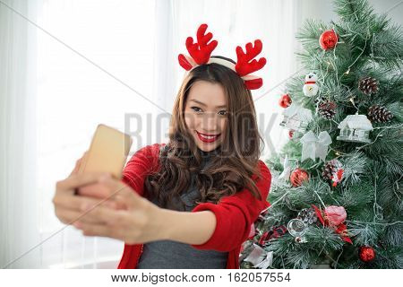 Woman Take Selfie On Phone With Christmas Hat Hold Christmas Gift Celebrating New Year