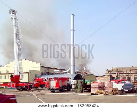 GOMEL BELARUS - APRIL 12 2016: Fire in building of production workshop of wallpaper factory