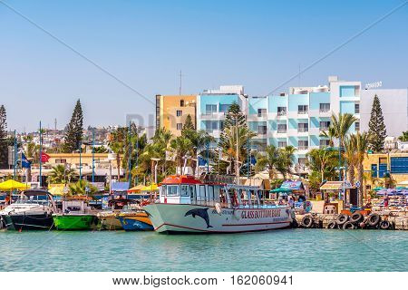 AYIA NAPA HARBOUR - JULY 16 2016: Harbor of Ayia Napa. Harbor is currently a famous tourist resort.