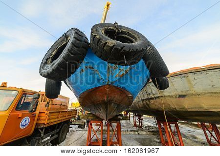 MOSCOW, RUSSIA - NOVEMBER 11, 2016: State Unitary Enterprise Mosvodostok performs recovery vessels on coastal winter parking. Ship mounted on metal supports.