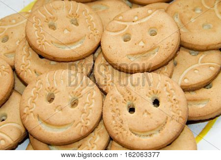 Food background of the round smiling cookies