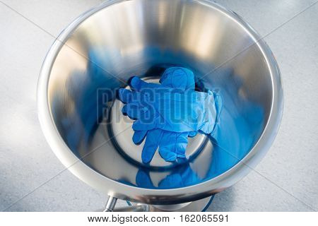 Surgical gloves used in trash bin