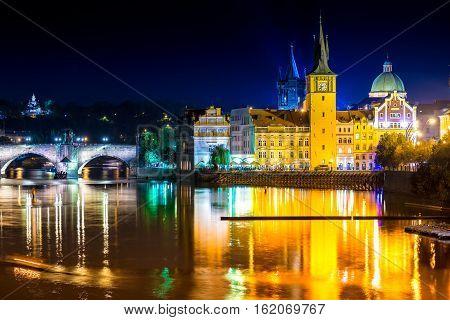 View of the Vltava river and Charles Bridge at dusk. Prague Czech Republic.