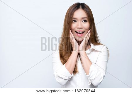 Young beautiful smiling Asian woman express surprised and excited.