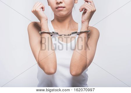 Sad woman with handcuffs. Violence and abuse with woman concept.