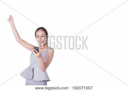 Potrait of young happy beautiful Asian woman arm up to celebrat and excite while holding smartphone mobile. Image with clipping path