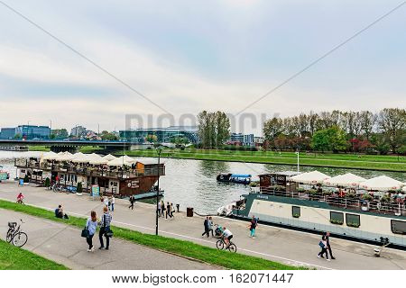 KRAKOW POLAND - OCTOBER 02: This is a view of the Vistula river and riverside walking path on October 02 2016 in Krakow