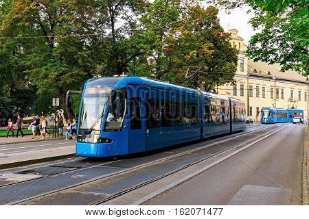 KRAKOW POLAND - OCTOBER 02: These are modern tram carriages in the downtown area of Krakow on October 02 2016 in Krakow