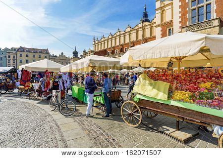 KRAKOW POLAND - OCTOBER 02: These are market stalls in the main square of Krakow city center where many tourists come to buy souvenirs on October 02 2016 in Krakow