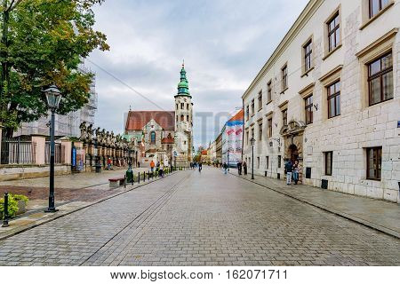 KRAKOW POLAND - OCTOBER 04: View of a street in old town Krakow near the main square with old traditional Polish buildings on October 04 2016 in Krakow