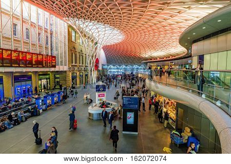 LONDON UNITED KINGDOM - OCTOBER 31: This is the interior of Kings Cross station where passengers come to view the departure and arrival board on October 31 2016 in London