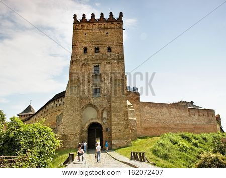 Lutsk Ukraine - June 01 2011: Tourists are visiting Lubart's Castle. Lutsk High Castle (Lubart's Castle) began its life in the mid-14th century as the fortified seat of Gediminas' son Lubart
