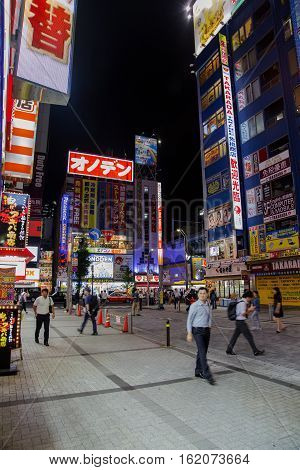 TOKYO, JAPAN - OCTOBER 5, 2016: Unidentified people on the street in Akihabara district in Tokyo. Akihabara is otaku cultural center and a shopping district for video games and computer goods