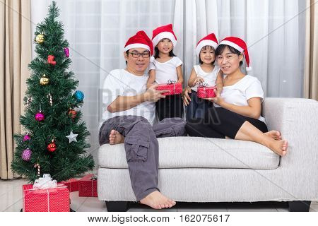 Happy Asian Chinese Family Exchange Christmas Gift At Home