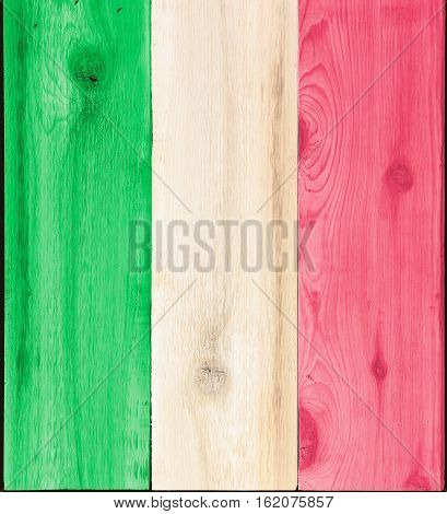 Timber planks of wood that have been painted or stained in the colors of a flag as a background for Italy or Italian items