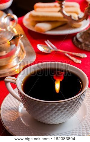 The Reflection Of The Flame In A Cup Of Tea