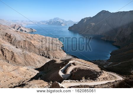 Small fjord seen from the top of one of the surrounding mountains, Jebel al Harim, Oman
