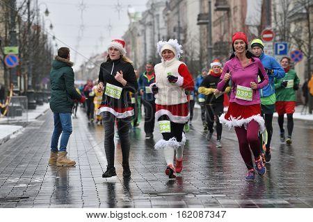 VILNIUS LITHUANIA - DECEMBER 18: Runners on traditional Vilnius Christmas race on 18 December 2016 in Vilnius Lithuania.