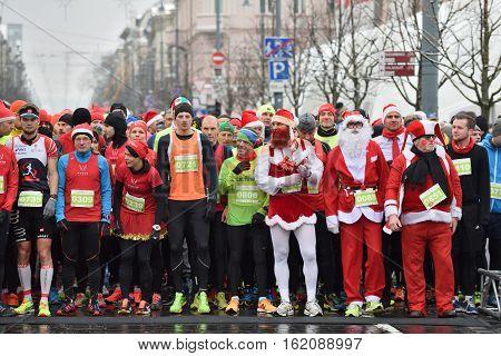 VILNIUS LITHUANIA - DECEMBER 18: Runners on start of traditional Vilnius Christmas race on 18 December 2016 in Vilnius Lithuania.
