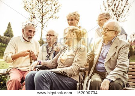 Seniors spending time at the park in the hospice