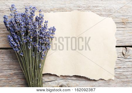 Bunch Of Lavender Flowers With Blank Sheet Of Paper On Grey Wooden Background