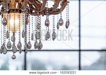beautiful crystal chandelier close-up shot with brightness background and copy space.