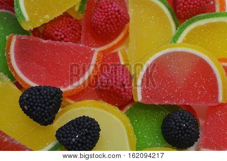 colorful marmalade in the form of pieces of fruit and berries