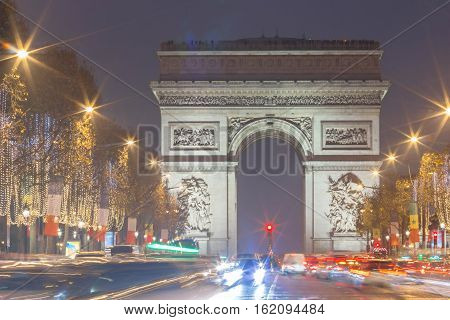 The Triumphal Arch and Champs Elysees avenue illuminated for  Christmas, Paris, France.