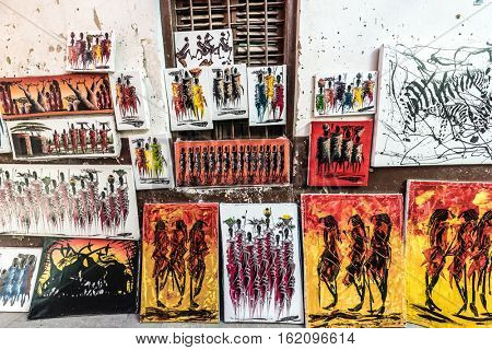 Stone Town, Zanzibar - July, 14, 2016: Editorial use - different colorful Zanzibar paintings on local street sale, Africa