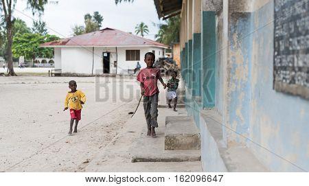 Zanzibar, Tanzania - July, 14, 2016: Editorial use - cute little african boys playing on a street in Zanzibar, Africa
