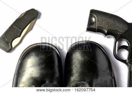 A knife hikes, black hiking boots and back gun on white background isolate