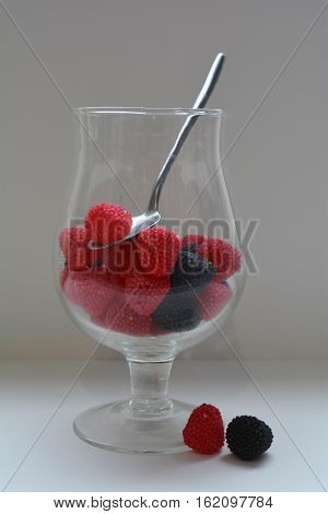 vase with berries, berry dessert on white background