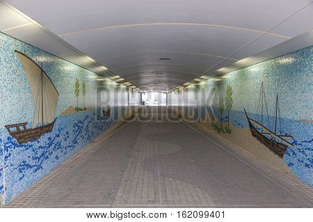ABU DHABI UAE - NOV 25 2016: Corniche tunnel with beautiful mosaic decoration in the city of Abu Dhabi United Arab Emirates