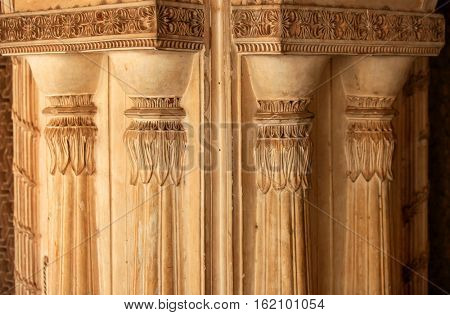 Intricate pillars architecture on historic Paigah tombs walls in India
