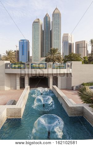 Fountain and highrise buildings at the corniche of Abu Dhabi United Arab Emirates