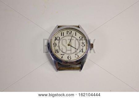 old watches without strap on a white background