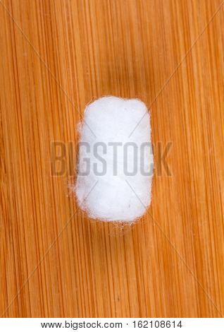 White Cotton Balls Isolated On Wood Background