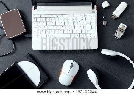 Computer peripherals & laptop accessories. Composition on stone counter