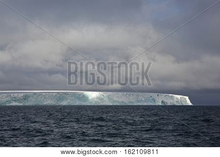Edge of the Arctic island covered with glacier