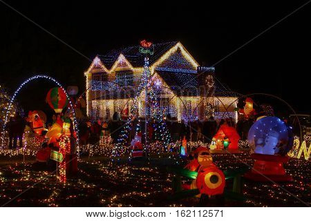 A Home decorated and lighted with 650000 lights and over 60 inflatables for Christmas and for New Year Eve at Night in Virginia