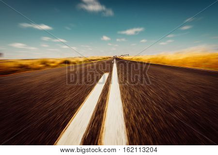 Asphalt road on Westen Australia .agricultural; agriculture; australia; australian; backgrounds; barley; blue; bread; bright; cereal; cleanup; clear; cloud; clouds; cloudy; color; conservation; cop; crop; crops; cultivated; day; dry; farm; farming; fertil