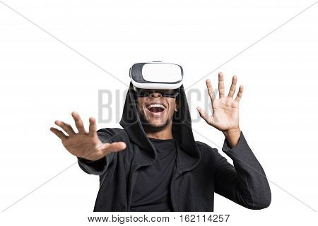 Isolated portrait of an African American young man in a hoodie wearing vr glasses and playing a video game. Mock up