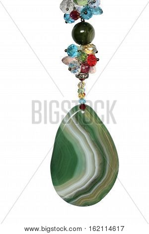 Fragment of multicolored jewelry with pendant made from green agate