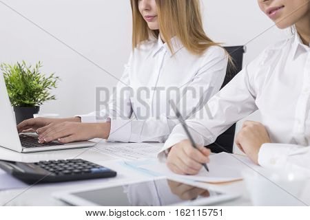 Side View Of Two Girls Working In An Office