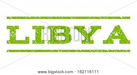 Libya watermark stamp. Text tag between horizontal parallel lines with grunge design style. Rubber seal stamp with unclean texture. Vector eco green color ink imprint on a white background.
