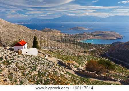 Church on a hilside on Halki island in Dodecanese archipelago, Greece.