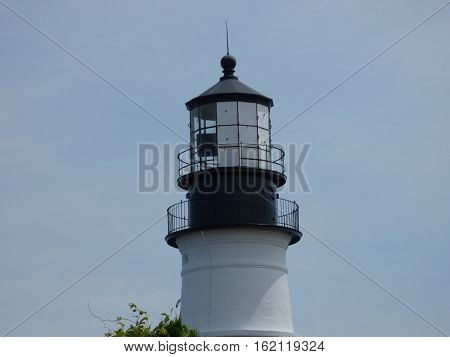 The top of a light house along the East Coast, showing lamp holder and reflector.