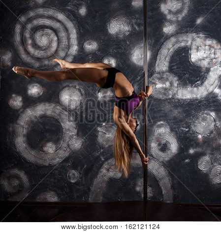 Young Pole Dance Woman. Sexy Woman Dance In A Studio