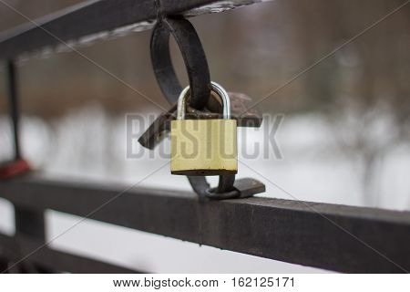 lock hangs on the bridge is a symbol of feelings between two people they lock it and throw away the keys