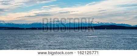 A panorama shot of the snow-capped peaks of the Olympic Mountains in Washington State.